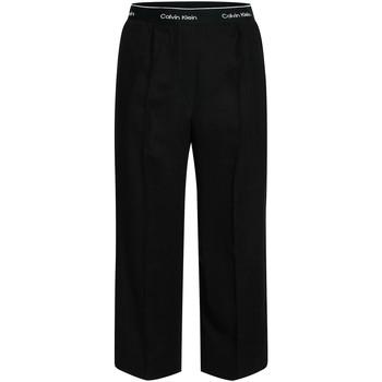 tekstylia Damskie Spodnie z lejącej tkaniny / Alladynki Calvin Klein Jeans K20K201766 Czarny