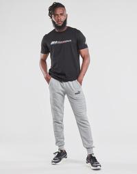 tekstylia Męskie Spodnie dresowe Puma ESS LOGO SLIM PANT LOGO FL CL Szary