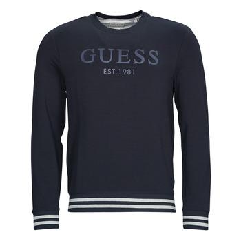 tekstylia Męskie Bluzy Guess BEAU CN FLEECE Czarny