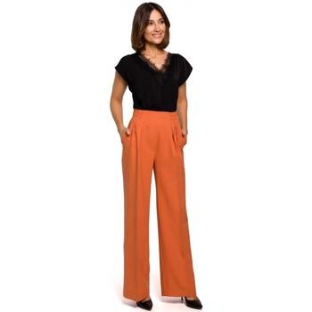tekstylia Damskie Spodnie z lejącej tkaniny / Alladynki Style S203 Palazzo trousers with elasticized waist - orange